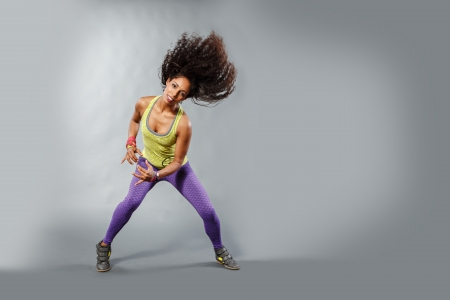 young woman at fitness exercise or zumba dancing Imagens - 25084558