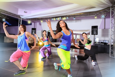 woman dancing: young women in sport dress at an aerobic and zumba exercise Stock Photo