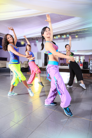 young women in sport dress at an aerobic and zumba exercise Banque d'images