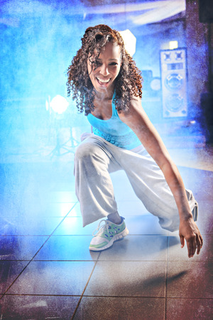 young woman in sport dress at an aerobic and zumba exercise photo