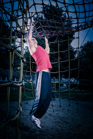 young man by training at outdoor fitness facility