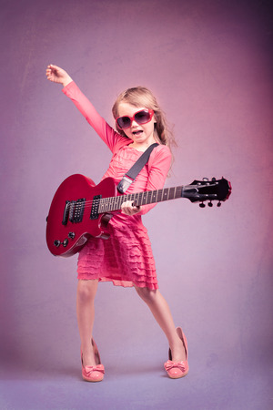 portrait of young girl with a guitar on the stage Imagens - 26902804