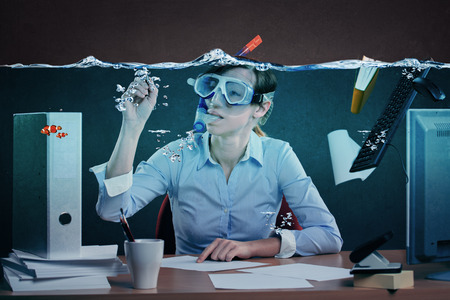 work. office: symbolic picture of a stressed female office worker and for stress at work Stock Photo