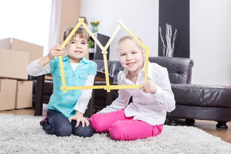 two young girls inside of their new home photo