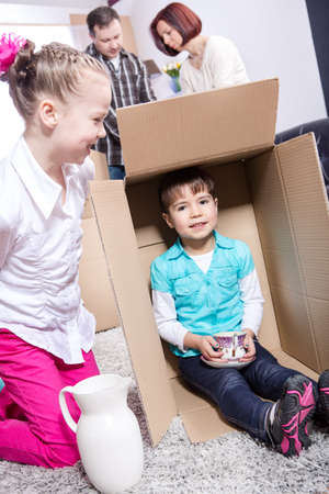 young family by packing for moving into a new home photo