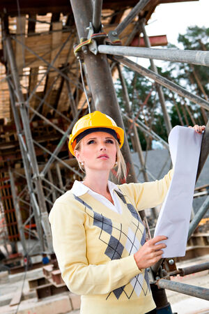 A young female constructor at building of a new motorway in Germany photo