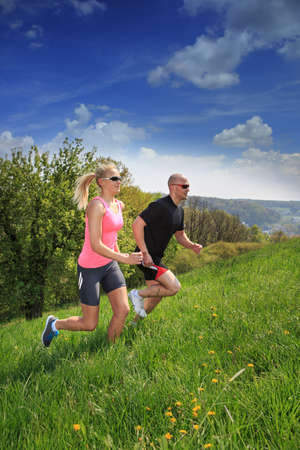 a couple jogging through rural landscape