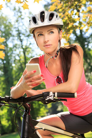 cycling woman taking a break in the park photo