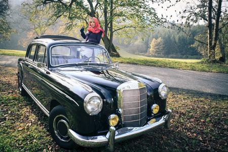 postwar: Girl in front of Post-War classic car