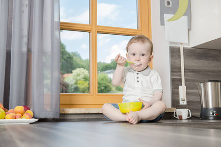 fmale: a one years old boy in the kitchen