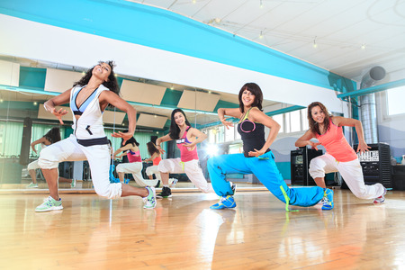 group of  women in sport dress at fitness dance exercise or aerobics photo