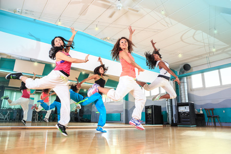 aerobic training: group of  women in sport dress at fitness dance exercise or aerobics