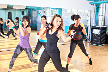 a group of women in sport dress at piloxing exercise 免版税图像