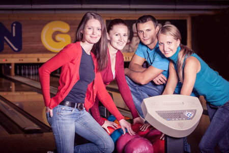 a young woman playing bowling photo