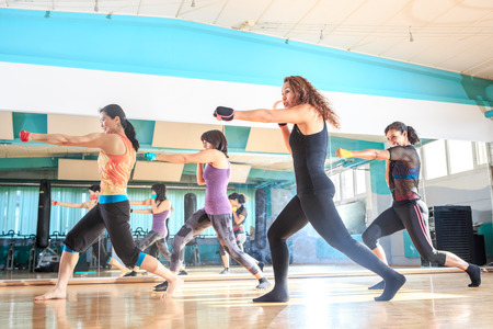 a group of women in sport dress at piloxing exercise Stock Photo