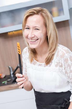 a woman making xmas cookies at home photo