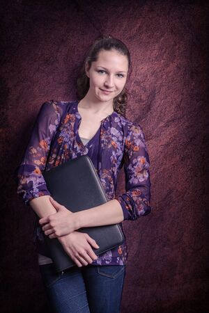 traineeship: A young girl in the office at the wall