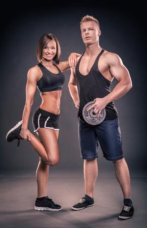 barbel: studio portrait of two young bodybuilder Stock Photo