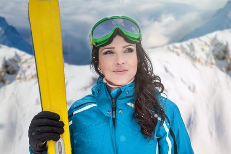 A woman skiing on the ski run in the Alps photo