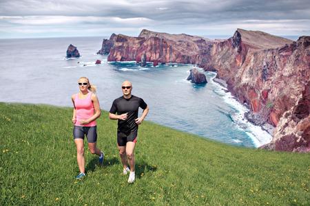 togheter: a couple jogging through rural landscape