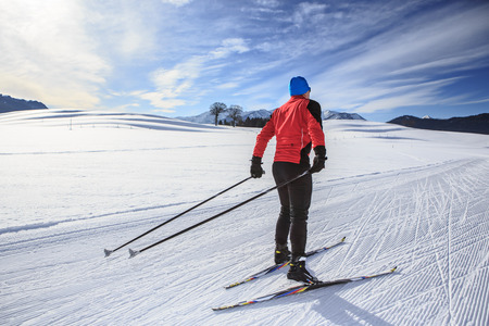 Ski Area: A man cross-country skiing on the trail in Bavaria