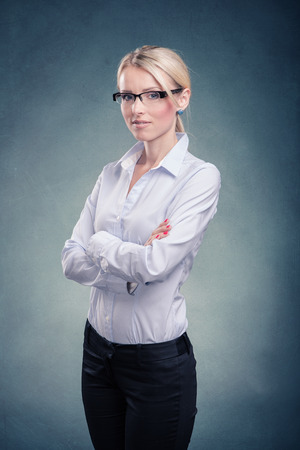financial official: studio portrait of a young businesswoman