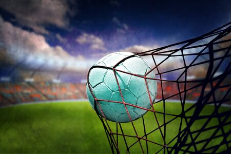 goal: symbolic picture for goal with a soccer ball in net Stock Photo