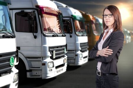 a businesswoman in front of cargo fleet