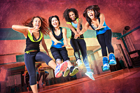 group of  women in sport dress jumping at fitness dance excercise or aerobics Banque d'images