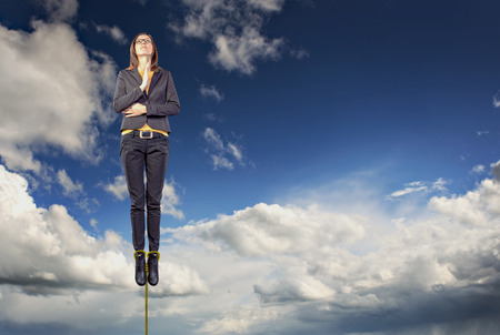 levitating: portrait of a business woman at levitating in the relaxing pose Stock Photo