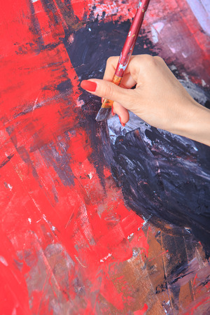 closeup of female painters hand at work