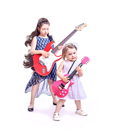 two little girls with the guitars on the stage