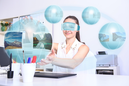 unrealistic: female designer with a virtual  computer of the future at work