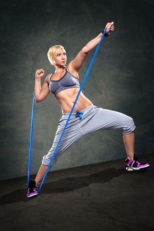 expander: young woman exercising with elastic expander