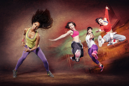 zumba: young woman at fitness exercise or zumba dancing