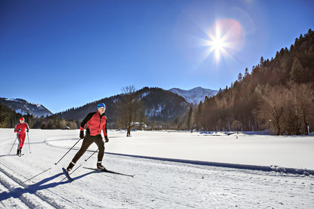 skiing: A group of cross-country skiers on the trail in Bavaria