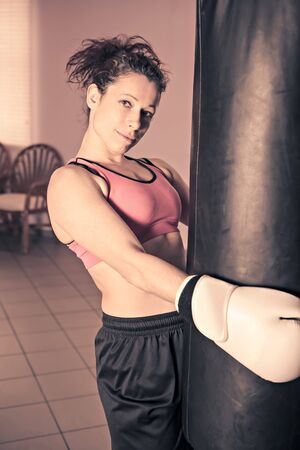 female boxer: female boxer during training in a gym