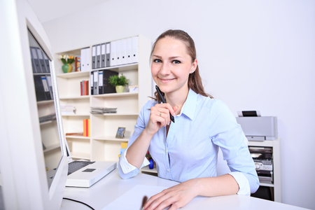 service desk: female fashion designer in the office at work Stock Photo