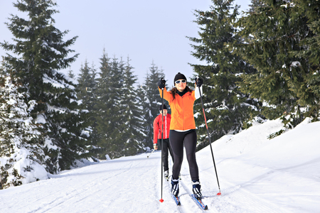snow ski: A woman cross-country skiing in the wintry forest