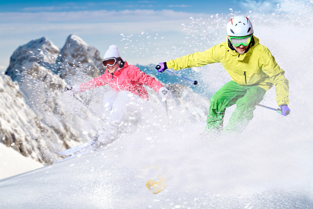 Two ski driver on the piste in Alps