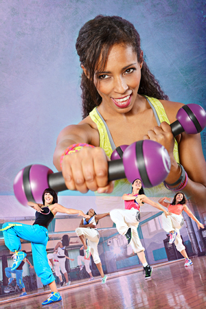 sport fitness: young woman with barbells at fitness exercise