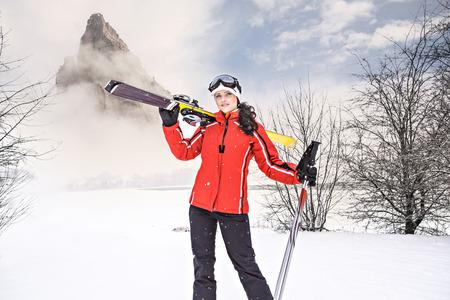 SKI: A woman skiing on the ski run in the Alps