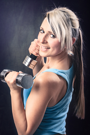 gym dress: young woman in sport dress at gym exercise Stock Photo
