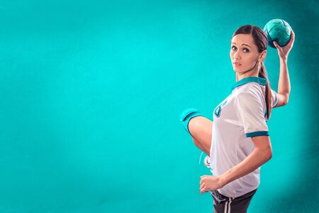 female handball player with a ball photo