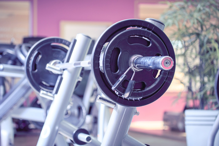 weight training: diverse equipment and machines at the gym room Stock Photo