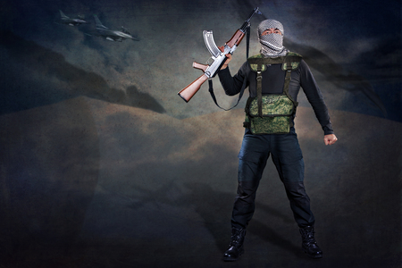 militant: symbolic picture of militants with firearms Stock Photo