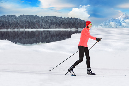 crosscountry: A woman cross-country skiing in the Alps