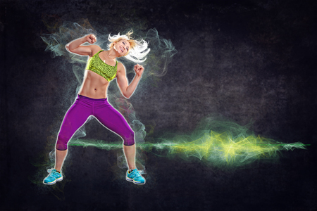 aerobics: young woman in sport dress at a fitness exercises like aerobics