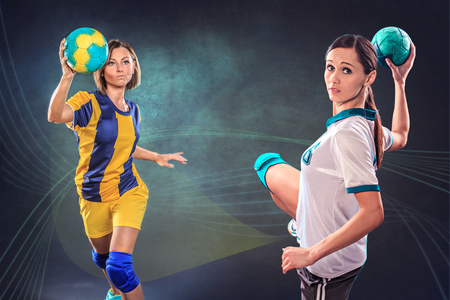female handball player with a ball on the field photo