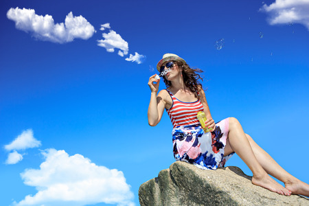clouds making: a young woman making clouds with soap bubbles Stock Photo